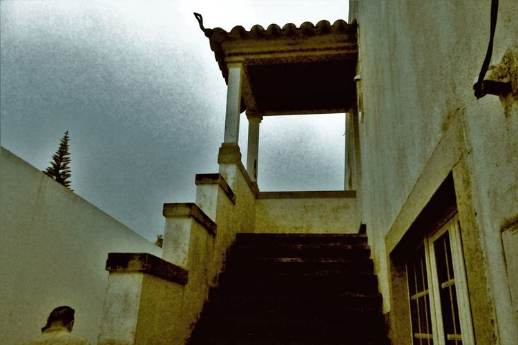 Everything Has An End Architectural Feature Architecture Black & White Boarding House Building Exterior Built Structure Cloud - Sky Day High Section History Holiday Low Angle View Manonthephone Outdoors Pinetree RainyDay Roof Sky Stairwell Steps Vacation
