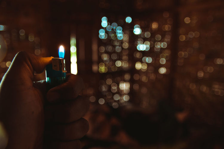 lighting up .. Light Travel Travel Destinations India Arunachal Pradesh NamdaphaNationalPark Hut Blue Bokeh Lighter Selective Focus Human Hand Photo Messaging Wireless Technology Technology Illuminated Photographing Mobile Phone Men Portable Information Device Flame Burning Heat Fire - Natural Phenomenon Lit Fire