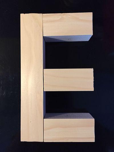 Wooden Letter E Against Black Background