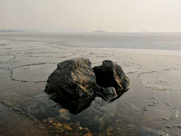 Sea rocks Japanese Sea Rock Rock - Object Stone Ice Seascape Winter Far East February Fog Water Sea Beach Silhouette Reflection Sky Horizon Over Water Close-up Foggy Floating In Water Mist