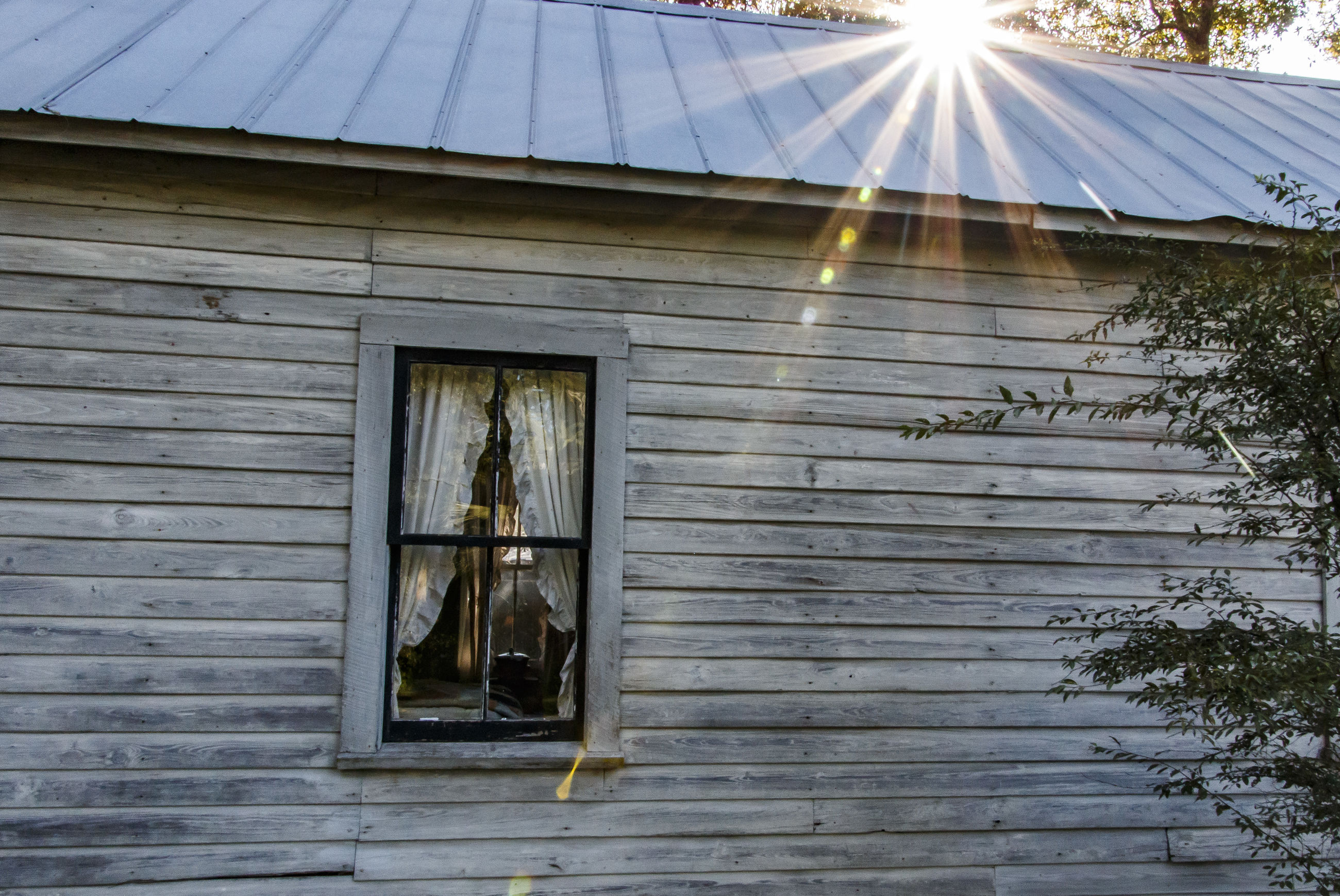 window, built structure, architecture, sunbeam, building exterior, house, lens flare, sun, day, outdoors, weathered, no people, window frame