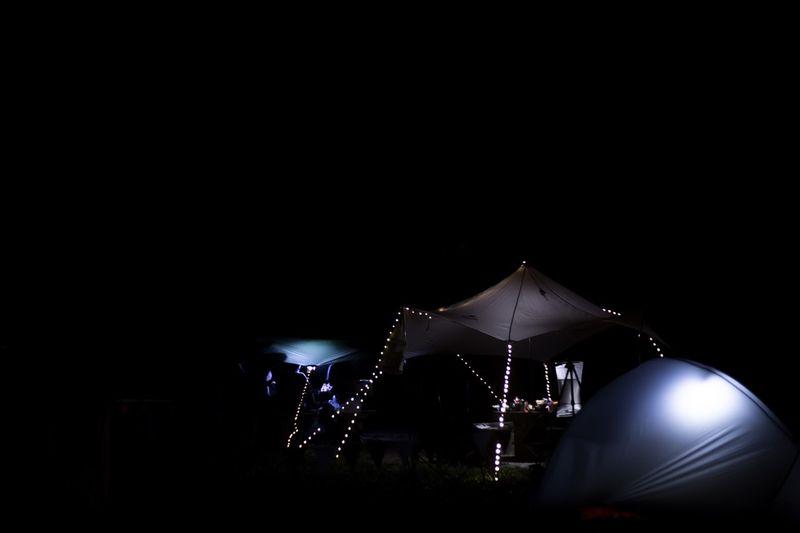 High section of illuminated amusement park at night