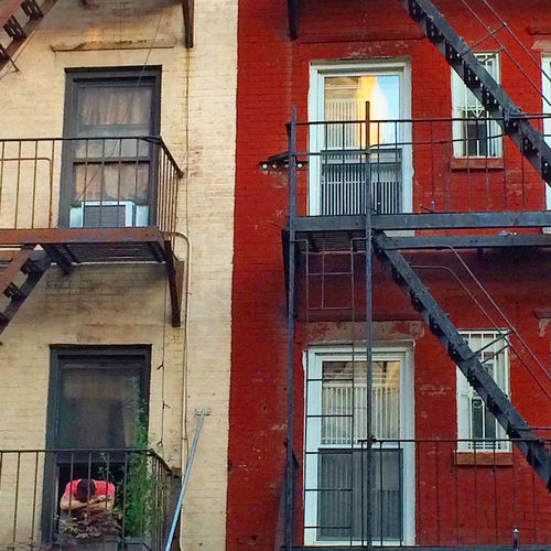 Lower East Side - Fire Escape Buildings Exterior Fire Escapes Man Mourning NYC Old Buildings Street Street Photography