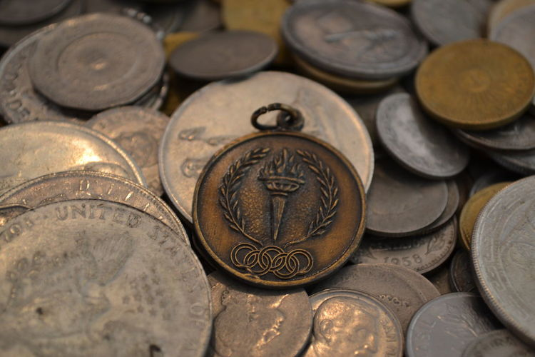 Bronze Medal Circle Close-up Coin Currency Day Finance Gold Colored Indoors  Investment Large Group Of Objects Medal Medals Metal Money No People Savings Wealth