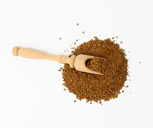 High angle view of coffee on table against white background