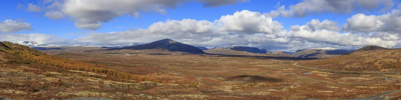 Dovre fjell panorama. This is a huge panorama of Dovre with Snöhetta to the left. The image is 133 megapixel. Clouds And Sky Mountains Mountain Range Mountain No People Scandinavia Orange Color Beauty In Nature Blue Sky White Clouds Fall Colors Scenic Norway Dovre Panorama Snow Capped Mountains