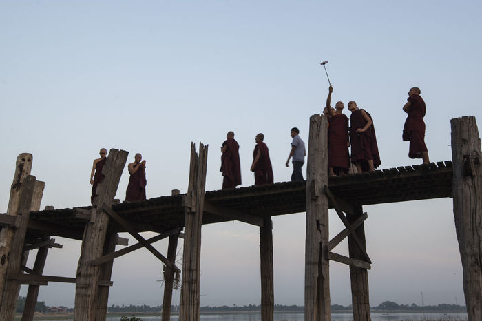 U-Bein Bridge, Mandalay, Myanmar Amarapura Attraction Bridge Burma Burmese Infrastructure Landmark Mandalay Monk  Myanmar Nature Outdoors People Sky Sunset Taung Tha Man Lake Teak Wood Teak Wood Bridge Travel Travel Destinations Travel Photography U-bein Bridge U-bein Bridge,Myanmar Ubeinbridge Water