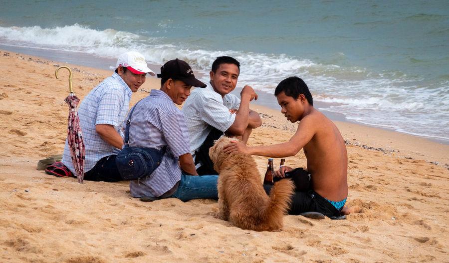 Friends sitting on beach