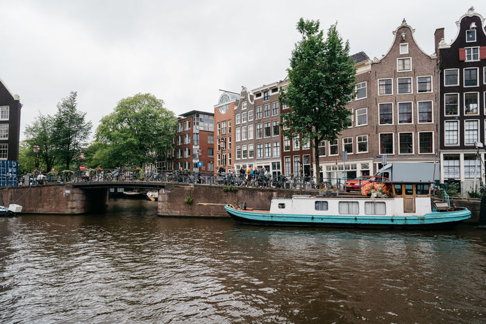 Amsterdam street scene Amsterdam Architecture Building Exterior Canal Canals Canals And Waterways Cannabis City City City Life Cityscape Cityscape Day European  Nautical Vessel No People Outdoors Red Light District Sky Street Tourism Travel Travel Destinations Tree Water