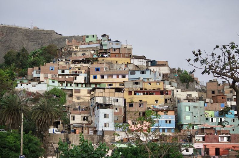 Architecture Building Exterior City Cityscape Colorful Community Day Favela House Lifestyles Nature No People Outdoors Poor  Residential Building Roof Sky Slum Social Issues Town