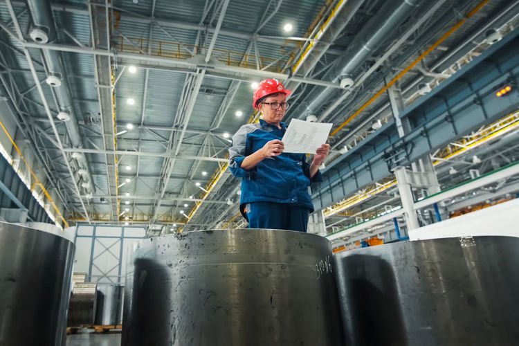 Low angle view of man working in factory