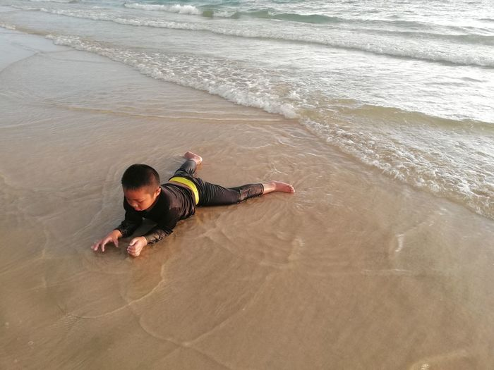 Children enjoy on summer trip 2019,หาดเจ้าหลาว Achi2019 Water Beach Sea Land Leisure Activity High Angle View One Person Real People Sand Lifestyles Motion Men Wave Child Full Length Childhood Nature Day Outdoors Boy
