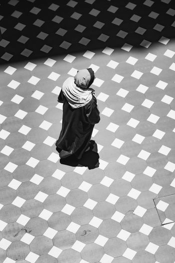 High angle view of woman walking on floor