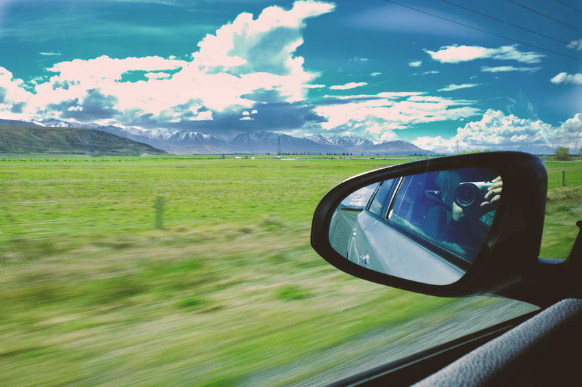 Car Land Vehicle Side-view Mirror Transportation Sky Reflection Day Mountain Field Land Window Nature Outdoors Road Trip Cloud - Sky Mirror Motor Vehicle Landscape Travel Shooting Photos Journey Tourism New Zealand Scenery Camera