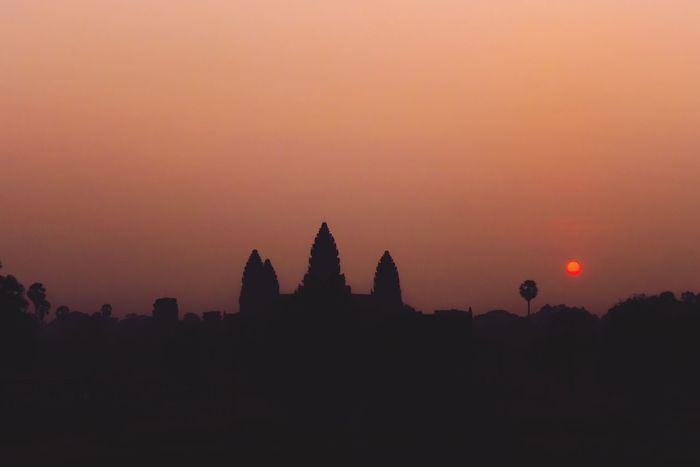Travel Lonelyplanet Cambodia Angkor Wat New Day Dawn Sunrise Sunset Silhouette Architecture Religion Sky Nature Scenics Travel Destinations Ancient Civilization Spirituality No People Tranquil Scene Beauty In Nature