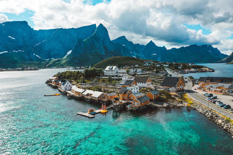Aerial view of a fishing village with yellow cabins in lofoten norway