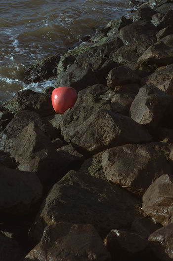 Balloon Beauty In Nature Day High Angle View Land Nature No People Outdoors Red Rock Rock - Object Rock Formation Sea Solid Stone - Object Sunlight Textured  Tranquility Water