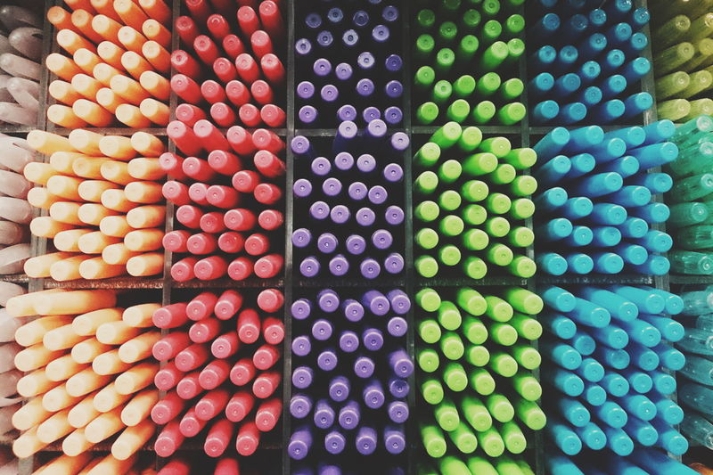 Full frame shot of colorful pens in rack for sale