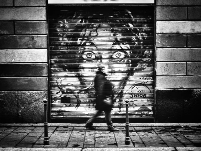 Daily Epiphany Milano Streetphotography Street Photography Streetphoto_bw Blackandwhite Black & White Black And White Photography Full Length Walking Art Art And Craft Standing Lifestyles Wall Wall - Building Feature Graffiti Auto Post Production Filter Built Structure Person Closed Front View Architecture Creativity Building Exterior Mask - Disguise Outdoors Casual Clothing