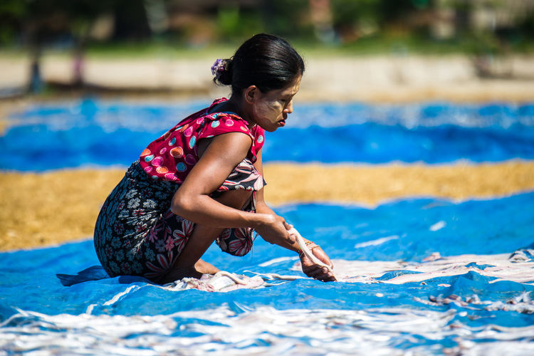 Childhood Day Dried Fish  Dry Fish Fishermen's Woman Full Length Leisure Activity Lifestyles in Ngapali Beach, Myanmar Outdoors Real People Side View Sommergefühle Sunlight Swimming Pool Water Young Adult Young Women