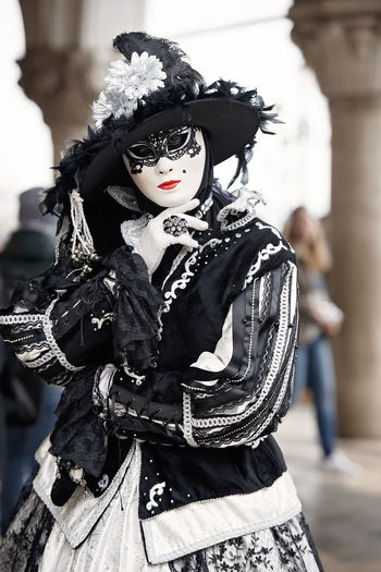 Midsection of woman with mask. venice carnival
