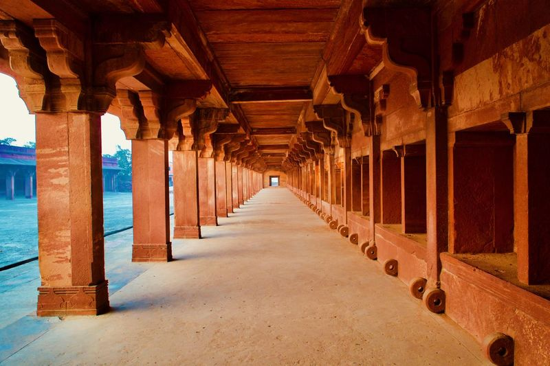 Huge horse stable inside ancient king's palace in india. little hole in the right bottom is to tie.