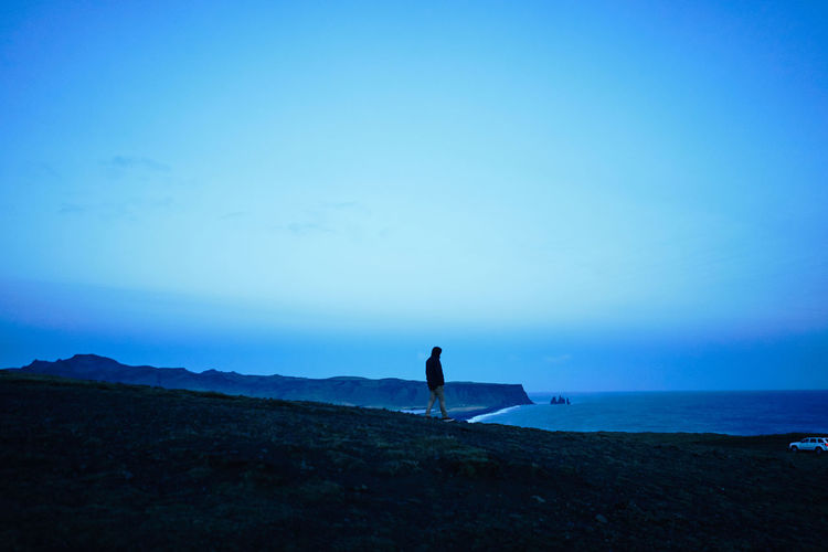 Beach Beauty In Nature Blue Coastline Horizon Over Water Iceland Iceland_collection Lifestyles Men Nature One Person Outdoors Real People Scenics Sea Silhouette Sky Tranquil Scene Tranquility Water EyeEmNewHere Break The Mold Shades Of Winter The Traveler - 2018 EyeEm Awards