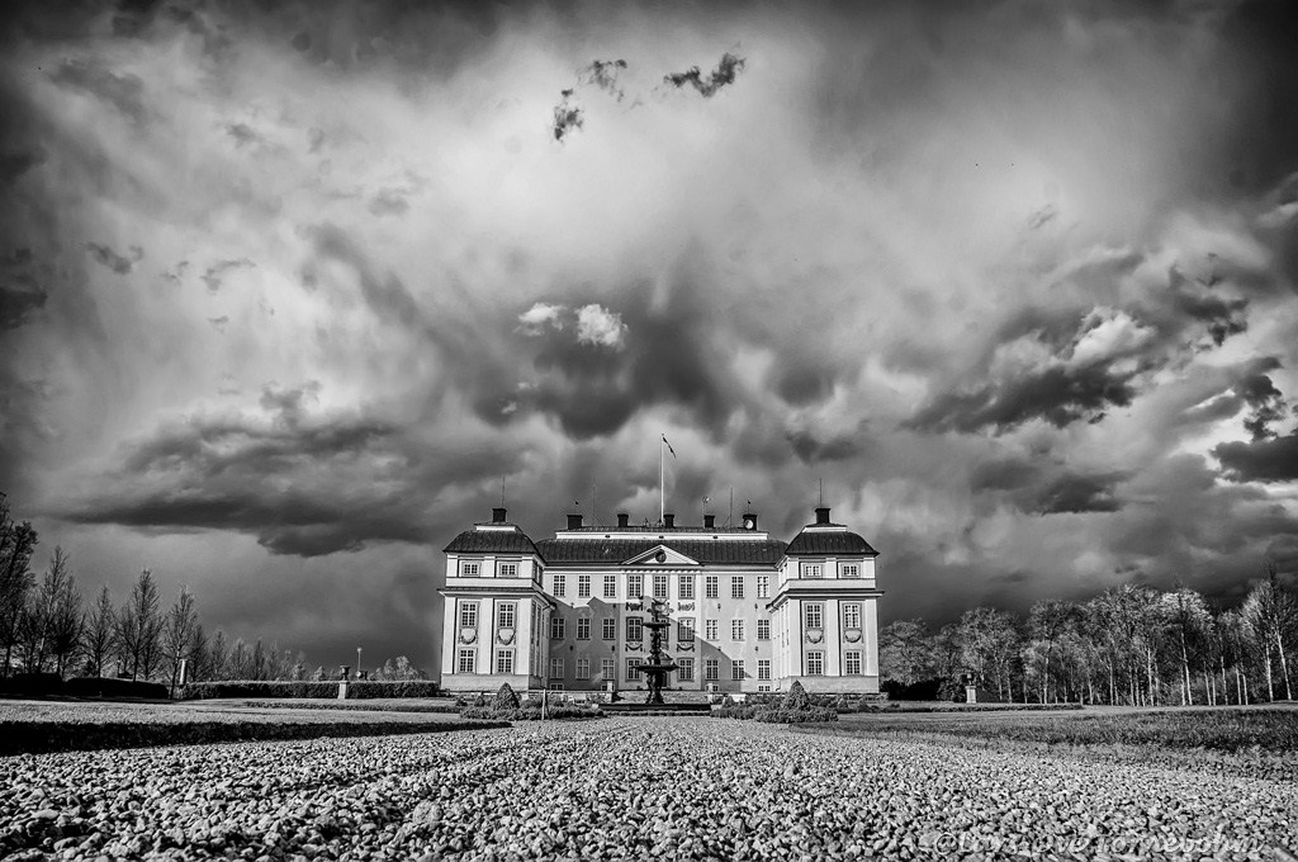 building exterior, architecture, built structure, sky, cloud - sky, field, cloudy, rural scene, house, landscape, grass, agriculture, overcast, cloud, weather, nature, day, farm, tree, outdoors