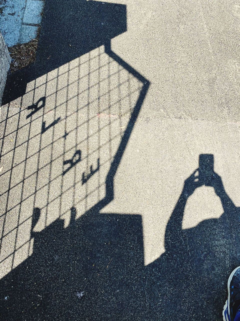 SHADOW OF PEOPLE ON STREET IN CITY ON SUNNY DAY