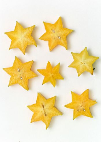 Slices of starfruit on white background Beauty Celebration Christmas Close-up Decoration Gold Colored No People Star Fruit  Star Shape White Background
