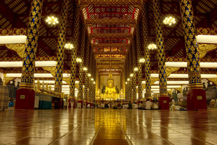 Illuminated lights in buddha temple