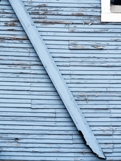 Old Wooden Building with Peeling Paint Architecture Backgrounds Building Exterior Built Structure Close-up Corrugated Iron Day Full Frame No People Outdoors Pattern Shutter Textured  Wood - Material