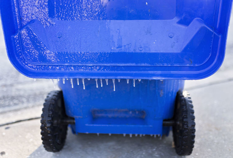 Icicles on the lid of a blue recycle bin Frozen Ice Icicles Winter Blue Cold Temperature Freeze Frozen Recycle Bin Ice On Trash Can Icy Recycle Bin Trash Can