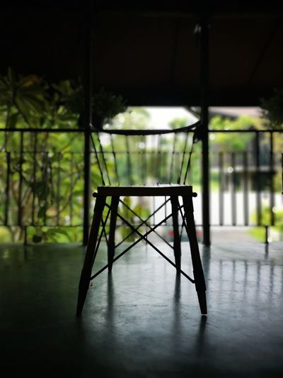 Empty chairs and table on floor