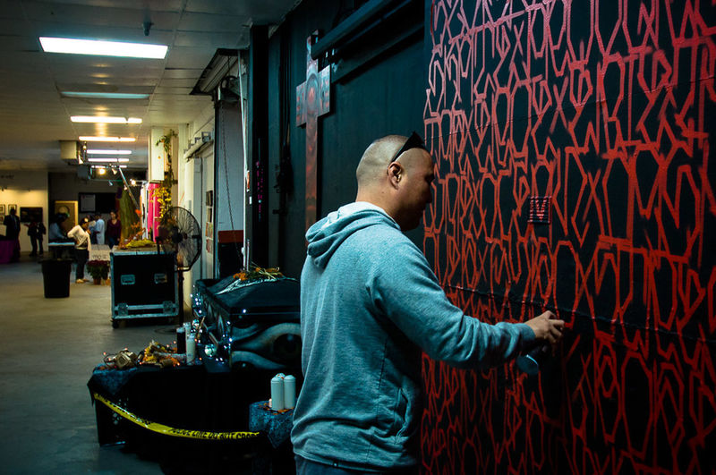 "Alex ""Defer"" Kizu painting at Self Help Graphics for their Day of the Dead event in Boyle Heights circa 2012. Losangeles California Digitalphotography Mural Artist Painting Deferk2s Deferism Nikond90 Nikon"