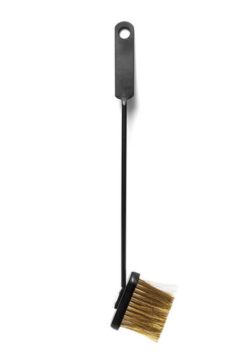 Close-up of fireplace tool against white background