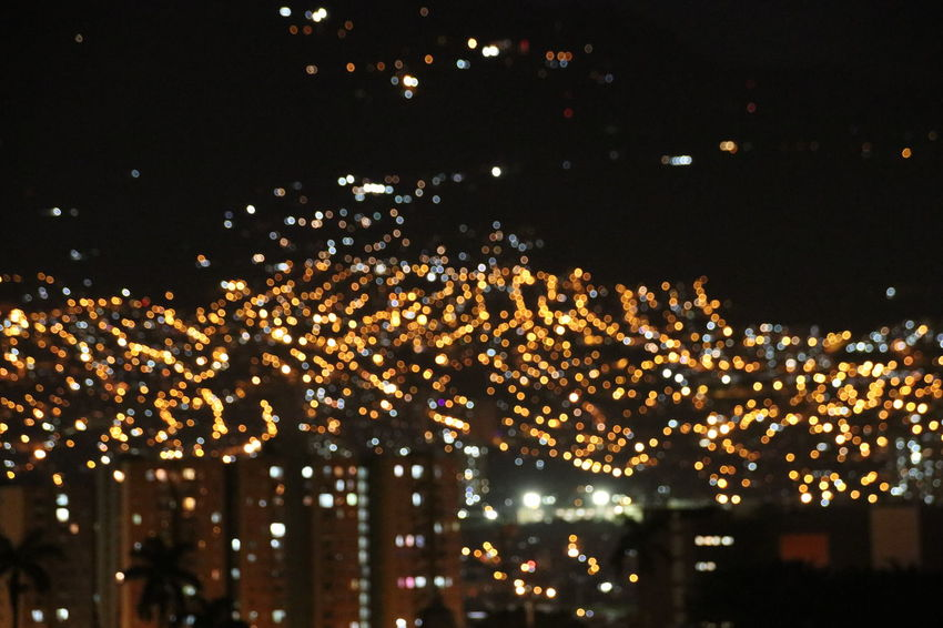 Medellín Architecture At Night Blurry Building Building Exterior Built Structure City City Life Cityscape cityscapes Decoration Glowing High Angle View Illuminated Light Lighting Equipment Nature Night No People Outdoors Sky Warm Light