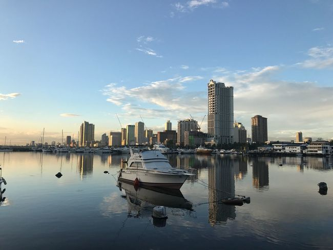 Jaysalvarez Photography Reflection Skyscraper Architecture Sky Water Building Exterior Built Structure Cloud - Sky Nautical Vessel Waterfront No People City Moored Travel Destinations Cityscape Outdoors Day Nature Urban Skyline
