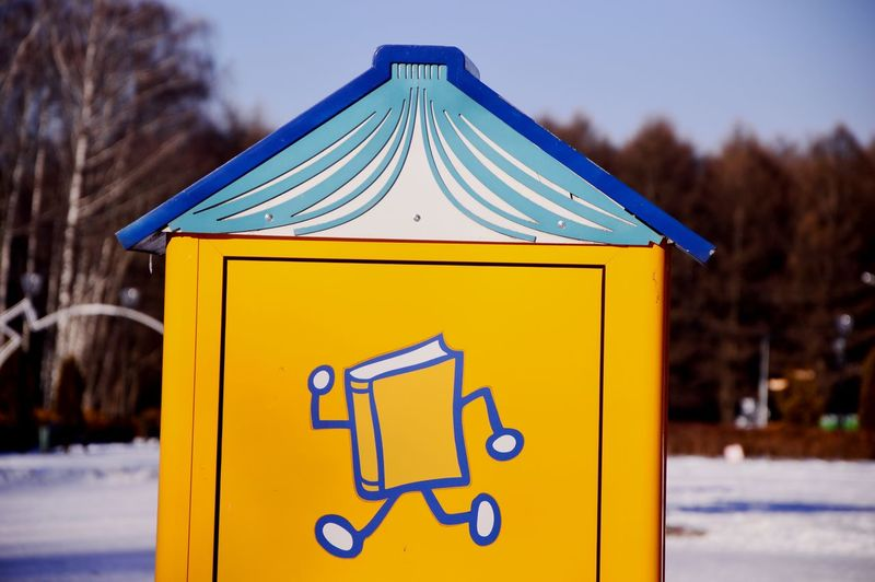 Close-up of yellow sign on snow