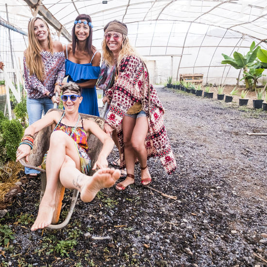 Portrait Of Happy Female Friends In Greenhouse