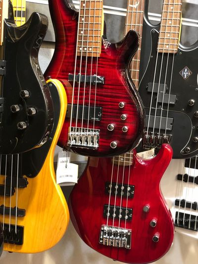 Gitarist String Instrument Musical Instrument Guitar Musical Equipment Music Musical Instrument String Arts Culture And Entertainment No People Still Life Bass Guitar Rock Music Electric Guitar Woodwind Instrument String Indoors  Close-up Fretboard High Angle View Wind Instrument Bass Instrument