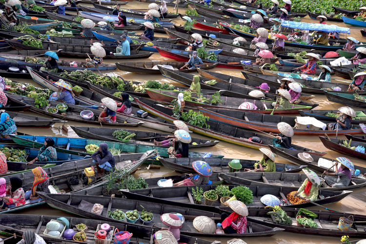 High Angle View Of People Selling Vegetables In Boat Over Lake At Market