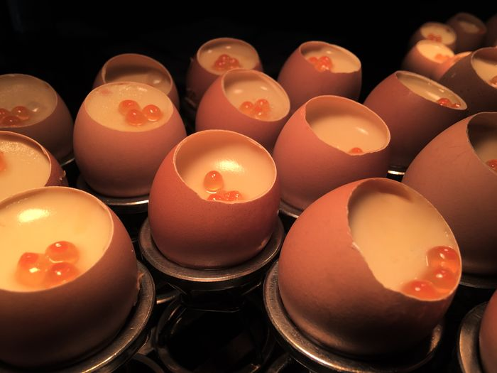 High angle view of lit candles in row