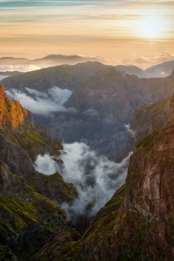 High angle view of waterfall against sky during sunset
