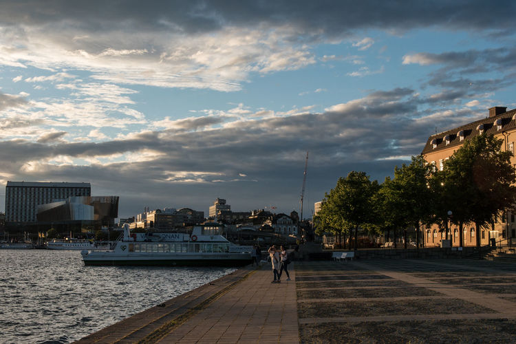 Architecture Building Exterior Built Structure City City Life Cityscape Cloud - Sky Dramatic Sky Evening Sky Long Outdoors Riddarsholmen Ship Sky Street The Way Forward Walking Walkway Water Waterfront