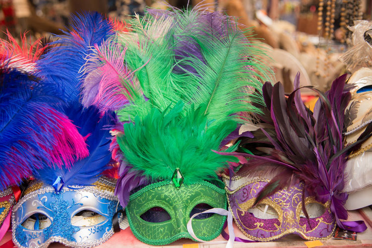 Close-up of masks at market stall