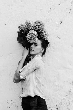 Bouquet Flowers Nature Photography Nature Woman EyeEm Selects Shadows & Lights Young Women Beautiful Woman Beauty Portrait Beautiful People Studio Shot Fashion Model White Background Smiling Curly Hair Wearing Flowers Hairstyle The Portraitist - 2018 EyeEm Awards