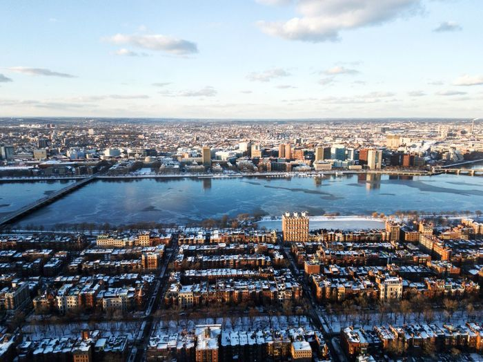 Photo of the cityscape of Boston, MA, USA captured in the evening in winter. The photo was made frome the Prudential tower Architecture Building Exterior Built Structure City Cityscape Cloud - Sky Day Evening Harbor High Angle View Nature Nautical Vessel No People Outdoors River Sky Water Waterfront