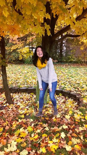 At the right moment Autumn Leaf Only Women Change One Woman Only Nature One Person Adult Long Hair Tree One Young Woman Only Smiling People Tranquility Front View Young Women Beauty In Nature Outdoors Beautiful Woman