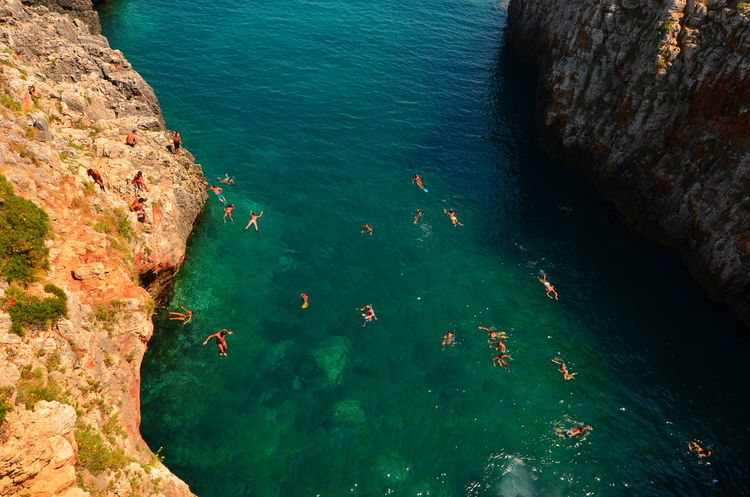 Aerial Shot Aerial View Bathe Bathers Colorful Colors Elevated View Nature Non-urban Scene Outdoors People Person Rock Rock - Object Scenics Sea Summer Swimming Vacation Water
